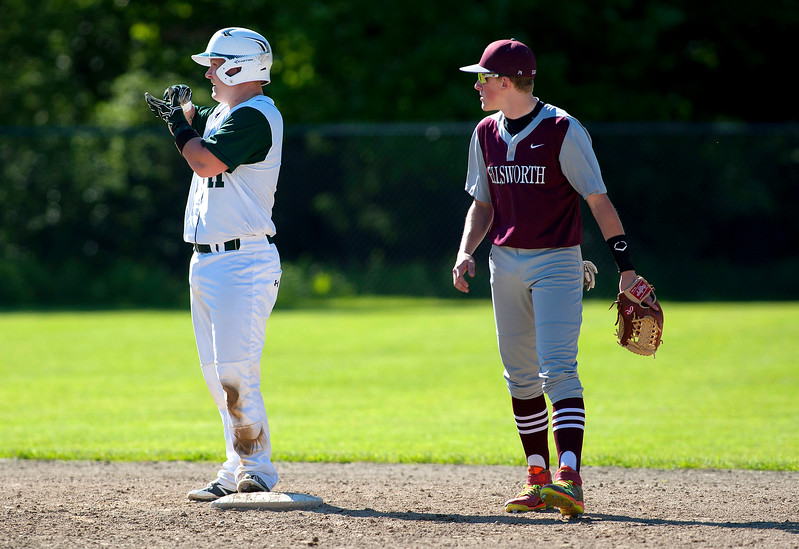 OLD TOWN, Maine -- 06/10/2017 - Old Town's Cole Daniel (left) motions to the bench after getting to second against Ellsworth during their semifinal baseball game in Old Town Saturday. Old Town won 2-0.  Ashley L. Conti   BDN