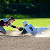 OLD TOWN, Maine -- 06/10/2017 - Ellsworth's Devin Grindle (left) stretches to tag Old Town's Jacob Ketch out at second during their semifinal baseball game in Old Town Saturday. Old Town won 2-0.  Ashley L. Conti | BDN