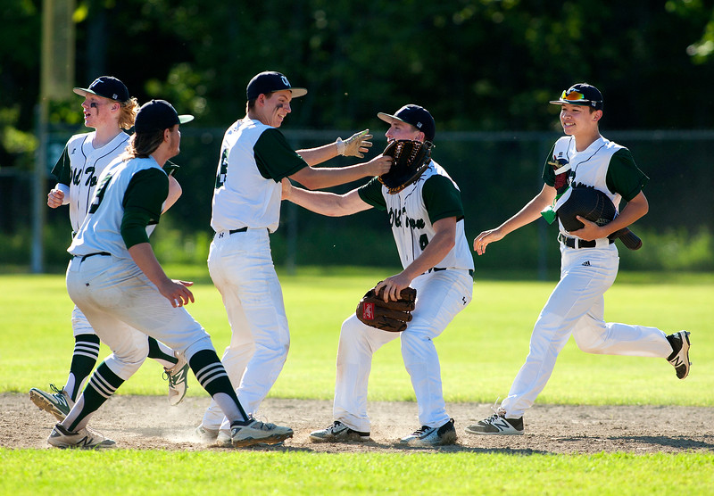 OLD TOWN, Maine -- 06/10/2017 - Old Town celebrates after defeating Ellsworth during their semifinal baseball game in Old Town Saturday. Old Town won 2-0.  Ashley L. Conti | BDN