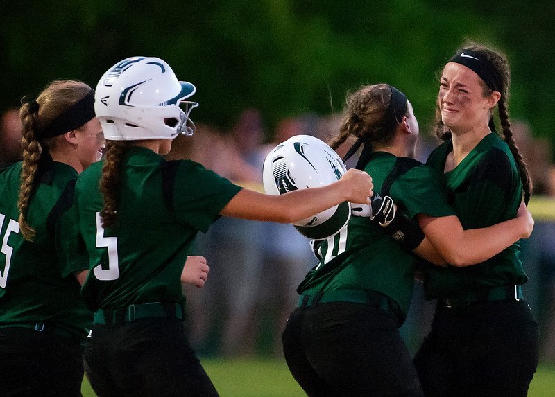 BREWER, Maine -- 06/13/2017 - Old Town's celebrates after defeating Oceanside during their Class B North softball championship game at Coffin Field in Brewer Tuesday. Ashley L. Conti | BDN