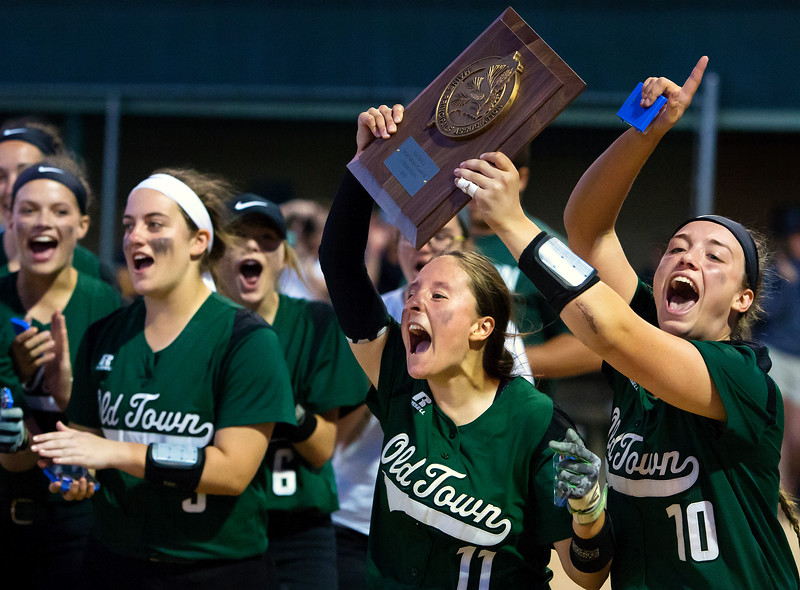 BREWER, Maine -- 06/13/2017 - Old Town celebrates after defeating Oceanside during their Class B North softball championship game at Coffin Field in Brewer Tuesday. Ashley L. Conti | BDN