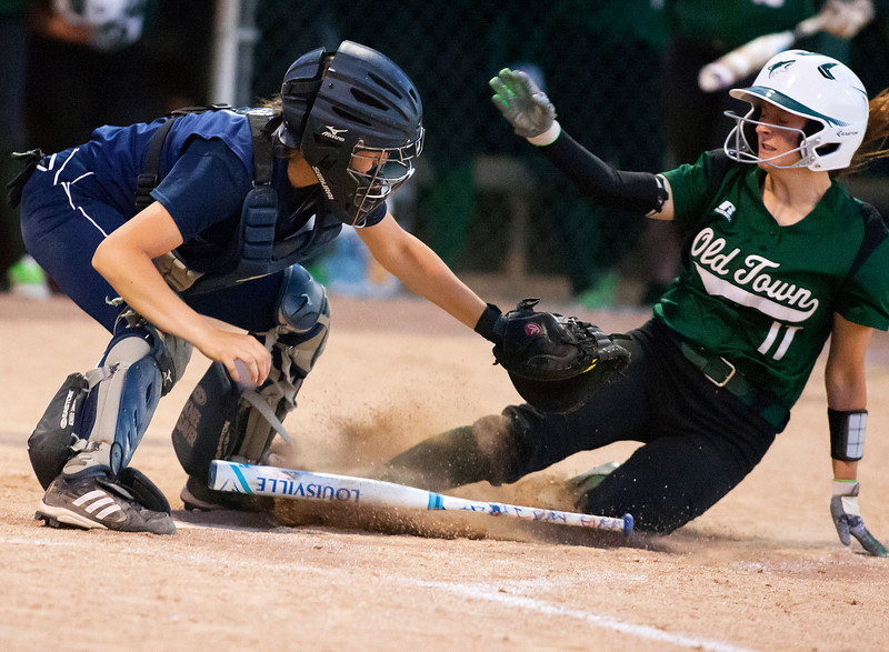 BREWER, Maine -- 06/13/2017 - Old Town's Natalie St. Louis (right) is tagged out at home by Oceanside's Abby Veiluex during their Class B North softball championship game at Coffin Field in Brewer Tuesday. Ashley L. Conti | BDN