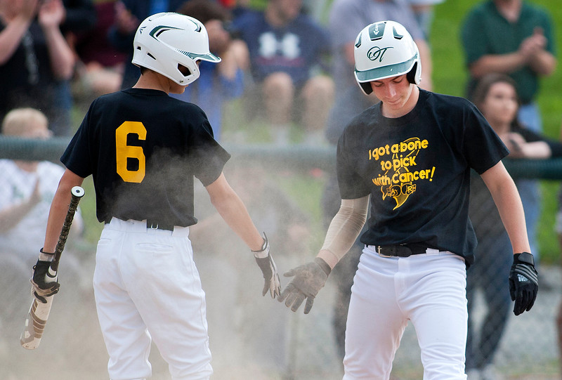 OLD TOWN, Maine -- 05/24/2017 - Old Town's Ryan Hoogterp (right) celebrates with teammate Nick Boutin after scoring a run against Orono during their baseball game in Old Town Wednesday. Ashley L. Conti | BDN