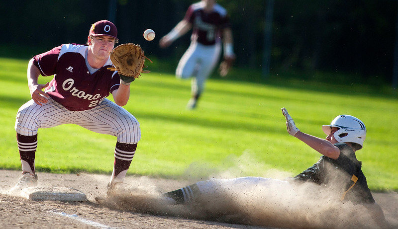 OLD TOWN, Maine -- 05/24/2017 - Old Town's Ryan Hoogterp (right) slides safely to third before Orono's Connor Robertson can make the tag during their baseball game in Old Town Wednesday. Ashley L. Conti | BDN