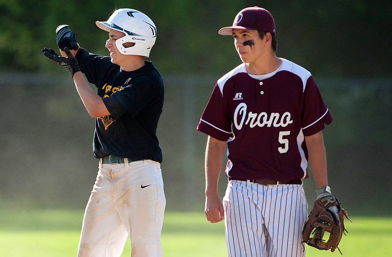 OLD TOWN, Maine -- 05/24/2017 - Old Town's Niko Knapp (left) celebrates after getting on second past Orono's Jayden Dana during their baseball game in Old Town Wednesday. Ashley L. Conti   BDN