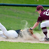 OLD TOWN, Maine -- 05/24/2017 - Old Town's Cole Daniel (left) dives safely back to third before Orono's Connor Robertson can make the tag during their baseball game in Old Town Wednesday. Ashley L. Conti | BDN