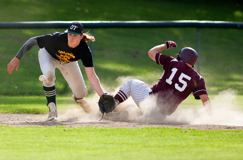 OLD TOWN, Maine -- 05/24/2017 - Orono's Connor McCluskey (right) slides safely to third before Ethan Stoddard can make the tag during their baseball game in Old Town Wednesday. Ashley L. Conti | BDN