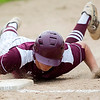 OLD TOWN, Maine -- 05/24/2017 - Orono's Nate DeSisto dives safely back to first past Old Town during their baseball game in Old Town Wednesday. Ashley L. Conti | BDN