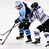 ORONO, Maine -- 03/07/2017 -- Old Town-Orono's Jacob Dubay (left) battles for control of the puck against Waterville's Zaharias Menoudarakos during their Class B North hockey championship game at Alfond Arena in Orono Tuesday. Ashley L. Conti   BDN