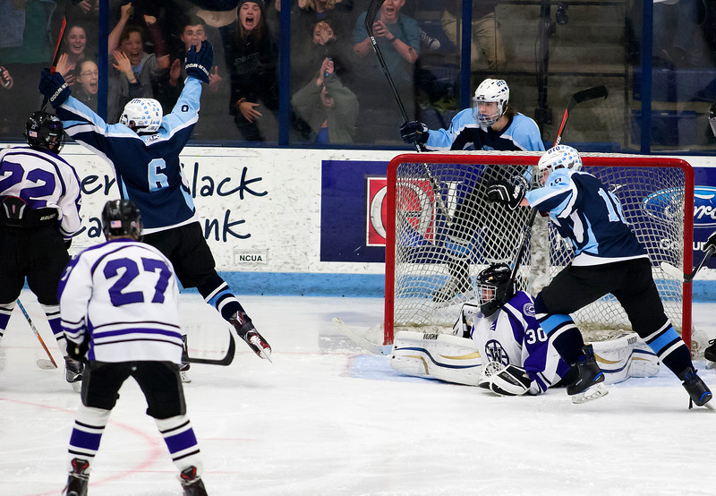 ORONO, Maine -- 03/07/2017 -- Old Town-Orono's Nick Boutin (left) celebrates after scoring on Waterville during their Class B North hockey championship game at Alfond Arena in Orono Tuesday. Ashley L. Conti   BDN