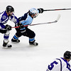 ORONO, Maine -- 03/07/2017 -- Old Town-Orono's Tyler Wheeler (right) and Waterville's Michael Bolduc battle for the puck during their Class B North hockey championship game at Alfond Arena in Orono Tuesday. Ashley L. Conti   BDN