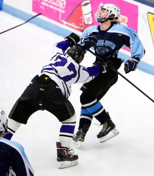 ORONO, Maine -- 03/07/2017 -- Waterville's Chase Wheeler (left) checks Old Town-Orono's Ben Allan-Rahill during their Class B North hockey championship game at Alfond Arena in Orono Tuesday. Ashley L. Conti   BDN