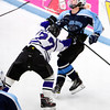 ORONO, Maine -- 03/07/2017 -- Waterville's Chase Wheeler (left) checks Old Town-Orono's Ben Allan-Rahill during their Class B North hockey championship game at Alfond Arena in Orono Tuesday. Ashley L. Conti | BDN