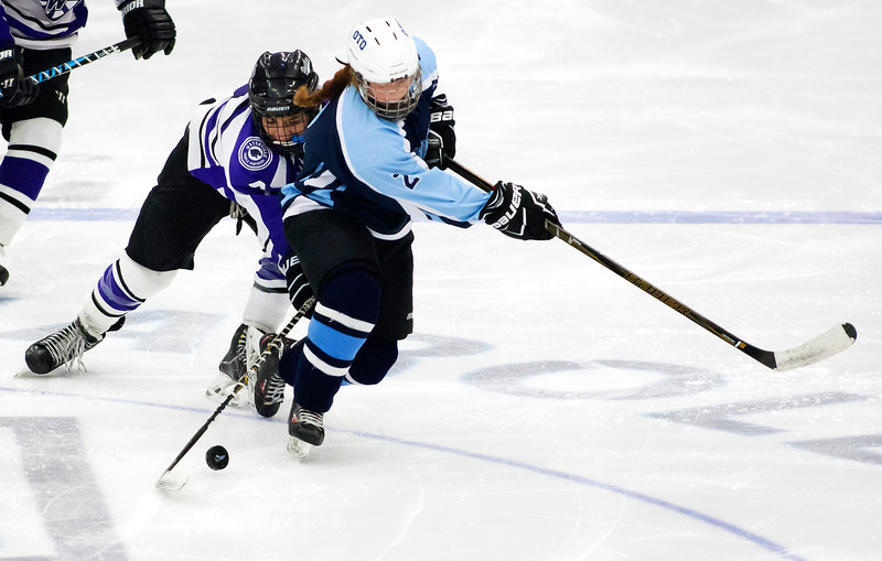 ORONO, Maine -- 03/07/2017 -- Waterville's Zaharias Menoudarakos (left) and Old Town-Orono's Olivia King battle for the puck during their Class B North hockey championship game at Alfond Arena in Orono Tuesday. Ashley L. Conti | BDN