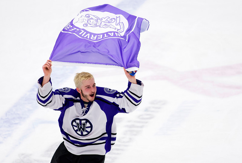 ORONO, Maine -- 03/07/2017 -- Waterville's Cody Pellerin does a victory lap after defeating Old Town-Orono during their Class B North hockey championship game at Alfond Arena in Orono Tuesday. Ashley L. Conti | BDN