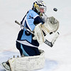 ORONO, Maine -- 03/07/2017 -- Old Town-Orono's Brenden Gasaway makes a save from Waterville during their Class B North hockey championship game at Alfond Arena in Orono Tuesday. Ashley L. Conti   BDN