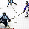 ORONO, Maine -- 03/07/2017 -- Waterville's Zaharias Menoudarakos (right) tries to shoot past Old Town-Orono's Brenden Gasaway (center) during their Class B North hockey championship game at Alfond Arena in Orono Tuesday. Ashley L. Conti   BDN