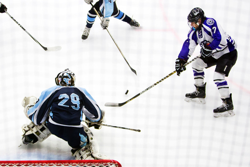 ORONO, Maine -- 03/07/2017 -- Waterville's Zaharias Menoudarakos (right) tries to shoot past Old Town-Orono's Brenden Gasaway (center) during their Class B North hockey championship game at Alfond Arena in Orono Tuesday. Ashley L. Conti | BDN
