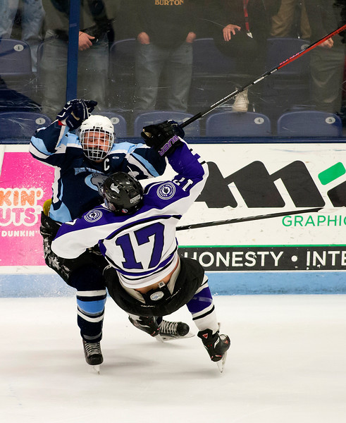 ORONO, Maine -- 03/07/2017 -- Old Town-Orono's Austin Sheehan (left) checks Waterville's Cooper Hart during their Class B North hockey championship game at Alfond Arena in Orono Tuesday. Ashley L. Conti | BDN