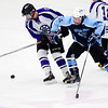 ORONO, Maine -- 03/07/2017 -- Waterville's Justin Wentworth (left) tries to regain control of the puck against Old Town-Orono's Sam Henderson during their Class B North hockey championship game at Alfond Arena in Orono Tuesday. Ashley L. Conti   BDN