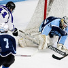 ORONO, Maine -- 03/07/2017 -- Old Town-Orono's Brenden Gasaway (right) stops a shot attempt from Waterville's Jackson Aldrich during their Class B North hockey championship game at Alfond Arena in Orono Tuesday. Ashley L. Conti   BDN
