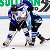 ORONO, Maine -- 03/07/2017 -- Waterville's Justin Wentworth (left) battles for the puck against Old Town-Orono's Nick Boutin during their Class B North hockey championship game at Alfond Arena in Orono Tuesday. Ashley L. Conti   BDN