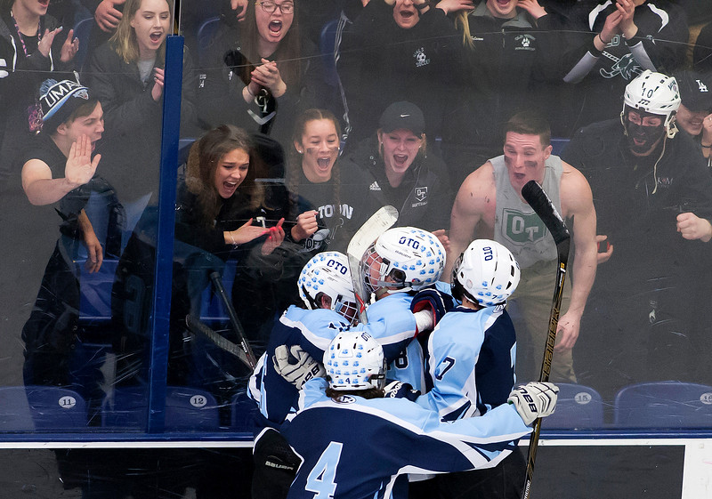 ORONO, Maine -- 03/07/2017 -- Old Town-Orono's Jacob Gallon (center) celebrates with teammates after scoring against Waterville during their Class B North hockey championship game at Alfond Arena in Orono Tuesday. Ashley L. Conti | BDN