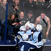 ORONO, Maine -- 03/07/2017 -- Old Town-Orono's Jacob Gallon (center) celebrates with teammates after scoring against Waterville during their Class B North hockey championship game at Alfond Arena in Orono Tuesday. Ashley L. Conti   BDN