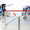 ORONO, Maine -- 03/07/2017 -- Old Town-Orono's Austin Sheehan (right) pushes the puck from in front of his team's net before Waterville can capitalize during their Class B North hockey championship game at Alfond Arena in Orono Tuesday. Ashley L. Conti   BDN