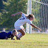 ORONO, Maine -- 09/27/2017 - Orono's Mille Braatvedt  (right) gets tripped up with Bucksport's Kiah Wilson during their soccer game in Orono Wednesday. Ashley L. Conti | BDN