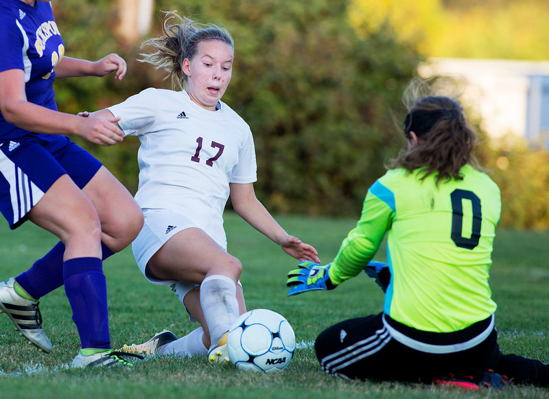 ORONO, Maine -- 09/27/2017 - Bucksport's Kaylee Knowles (right) makes a sliding save against Orono's Mille Braatvedt  during their soccer game in Orono Wednesday. Ashley L. Conti | BDN