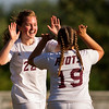 ORONO, Maine -- 09/27/2017 - Orono's Lauren Melanson (left) celebrates with Isabella Baker after scoring a goal against Bucksport during their soccer game in Orono Wednesday. Ashley L. Conti | BDN