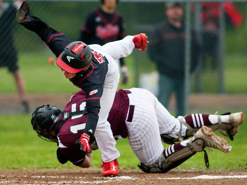 ORONO, Maine -- 05/31/2017 - Orono's Connor McCluskey (left) tags out Central's Mike Kelly at home during their baseball game at Orono Wednesday.  Ashley L. Conti | BDN