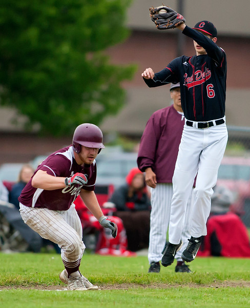 ORONO, Maine -- 05/31/2017 - Orono's Connor McCluskey (left) tries to run home before Central's Caleb Shaw can make the throw during their baseball game at Orono Wednesday.  Ashley L. Conti | BDN