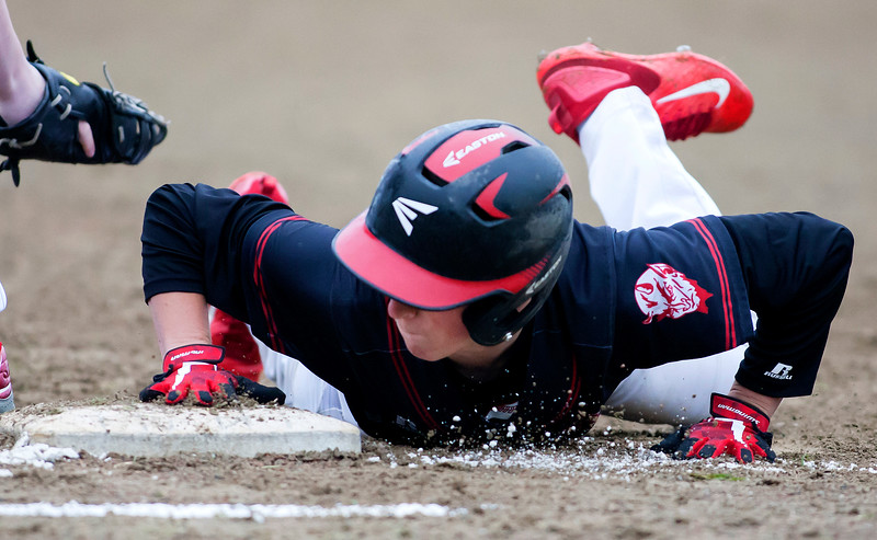 ORONO, Maine -- 05/31/2017 - Central's Mike Kelly dives back to first before Orono's Noah White can make the tag during their baseball game at Orono Wednesday.  Ashley L. Conti | BDN
