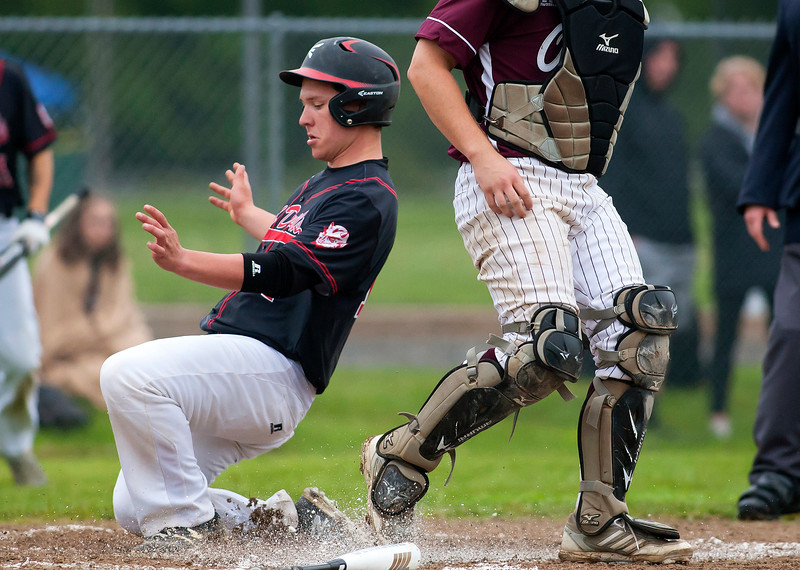 ORONO, Maine -- 05/31/2017 - Central's Andrew Speed sneaks past Orono's Connor McCluskey for a run during their baseball game at Orono Wednesday.  Ashley L. Conti | BDN