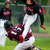ORONO, Maine -- 05/31/2017 - Orono's Connor McCluskey (left) tags out a leaping Central's Mike Kelly at home during their baseball game at Orono Wednesday.  Ashley L. Conti | BDN