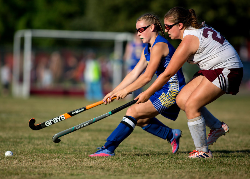 ORONO, Maine -- 09/13/2017 - Hermon's Elise McKay (left) and Orono's Camryn Brown battle for the ball during their field hockey game at Orono Wednesday. Ashley L. Conti | BDN