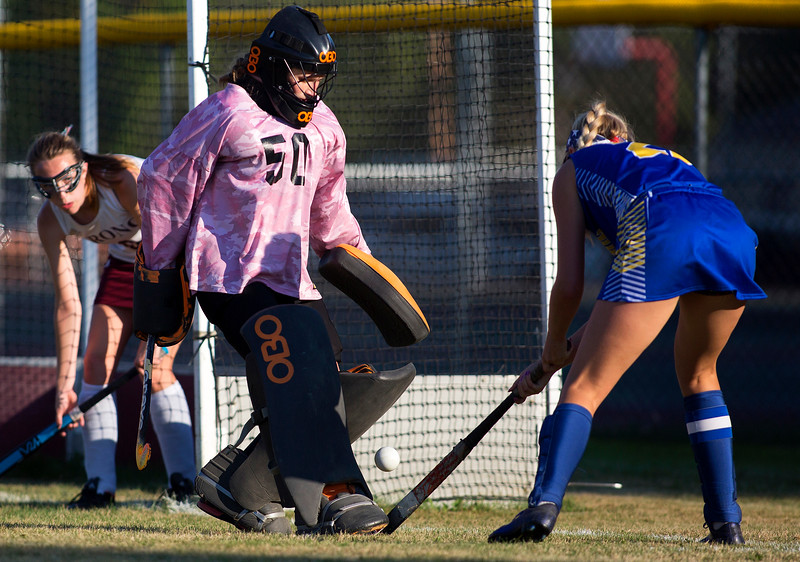 ORONO, Maine -- 09/13/2017 - Orono's Roisin Rumsey (center) stops a shot from Hermon's Madison Pollen during their field hockey game at Orono Wednesday. Ashley L. Conti | BDN