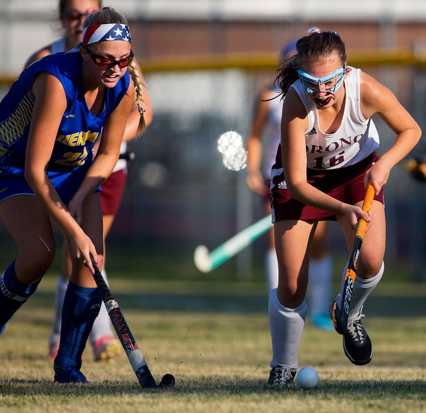 ORONO, Maine -- 09/13/2017 - Hermon's  Madison Pollen (left) and Orono's Becky Tocci battle for control of the ball during their field hockey game at Orono Wednesday. Ashley L. Conti | BDN