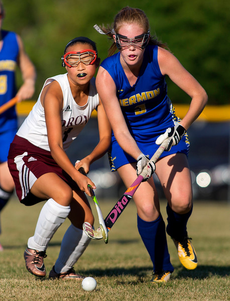 ORONO, Maine -- 09/13/2017 - Orono's Molly Booth (left) and Hermon's Olivia Fish battle for the ball during their field hockey game at Orono Wednesday. Ashley L. Conti | BDN