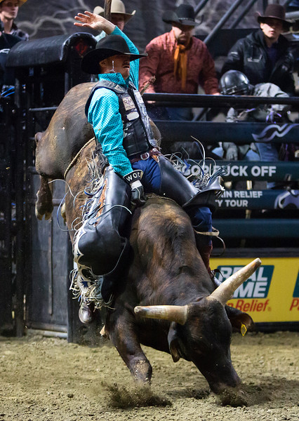 "BANGOR, Maine -- 03/11/2017 -- Taylor Toves tries to hang on to Pokemon during the Professional Bull Riders Velocity Tour ""Bangor Buck Off,"" at Cross Insurance Center in Bangor Saturday. Ashley L. Conti 
