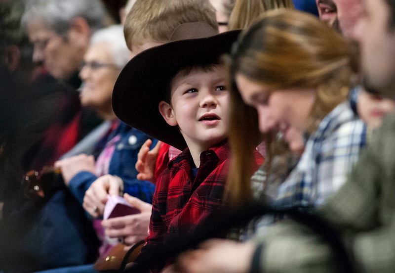"""BANGOR, Maine -- 03/11/2017 -- A young fan watches during the Professional Bull Riders Velocity Tour """"Bangor Buck Off,"""" at Cross Insurance Center in Bangor Saturday. Ashley L. Conti   BDN"""