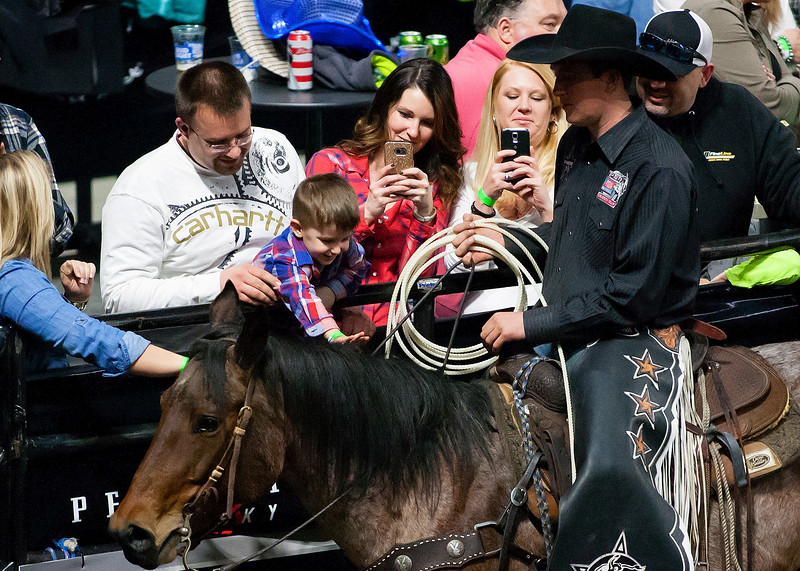 """BANGOR, Maine -- 03/11/2017 -- A young fan pets a horse during the Professional Bull Riders Velocity Tour """"Bangor Buck Off,"""" at Cross Insurance Center in Bangor Saturday. Ashley L. Conti 