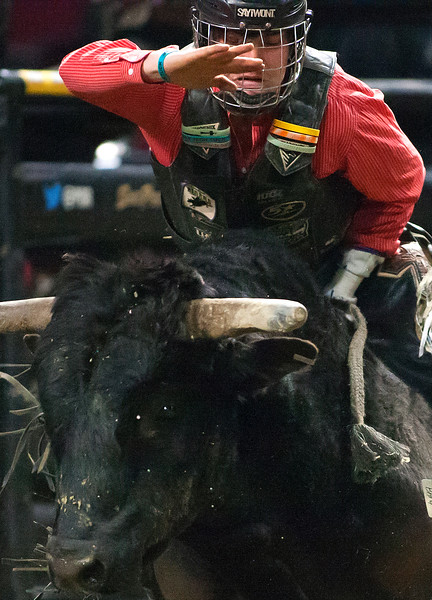 "BANGOR, Maine -- 03/11/2017 -- Dylan Madsen tries to hang on to Heat Seeker during the Professional Bull Riders Velocity Tour ""Bangor Buck Off,"" at Cross Insurance Center in Bangor Saturday. Ashley L. Conti 