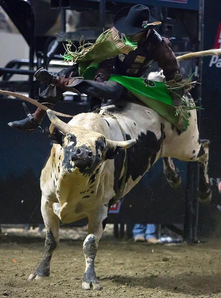 "BANGOR, Maine -- 03/11/2017 -- Ricky Agular rides Turbo during the Professional Bull Riders Velocity Tour ""Bangor Buck Off,"" at Cross Insurance Center in Bangor Saturday. Ashley L. Conti | BDN"