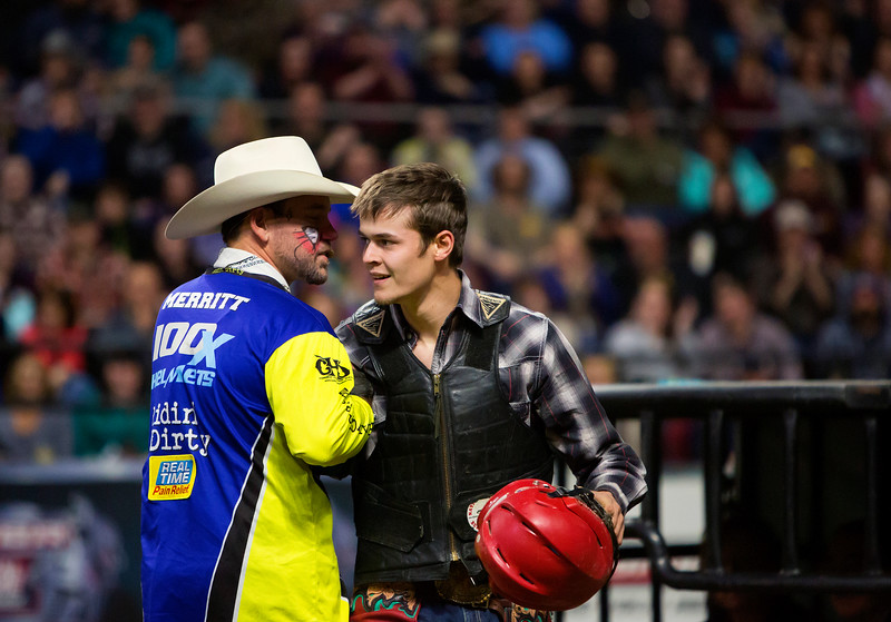 "BANGOR, Maine -- 03/11/2017 -- Eli Miller (right) celebrates after riding Radar during the Professional Bull Riders Velocity Tour ""Bangor Buck Off,"" at Cross Insurance Center in Bangor Saturday. Ashley L. Conti 