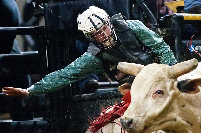 "BANGOR, Maine -- 03/11/2017 -- Lamar Lehman tries to stay on Hacksaw Ridge during the Professional Bull Riders Velocity Tour ""Bangor Buck Off,"" at Cross Insurance Center in Bangor Saturday. Ashley L. Conti | BDN"