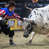 """BANGOR, Maine -- 03/11/2017 -- A bullfighter distracts Smokin Do Dad during the Professional Bull Riders Velocity Tour """"Bangor Buck Off,"""" at Cross Insurance Center in Bangor Saturday. Ashley L. Conti 