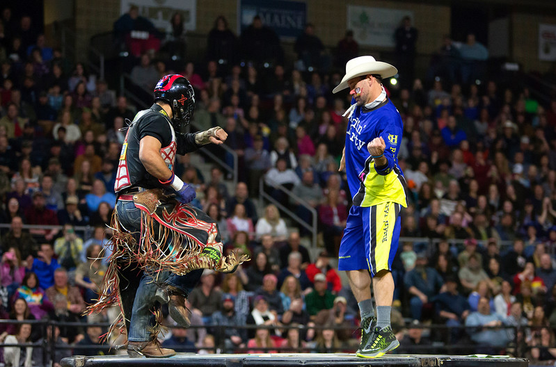 """BANGOR, Maine -- 03/11/2017 -- Robson Aragoa (left) dances after riding Colt .45 during the Professional Bull Riders Velocity Tour """"Bangor Buck Off,"""" at Cross Insurance Center in Bangor Saturday. Ashley L. Conti   BDN"""